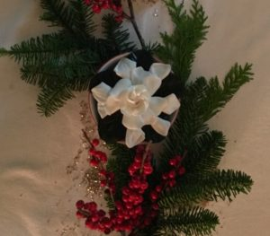 gardenia-with-evergreen-and-holly-berries
